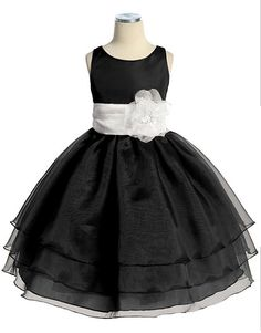 Black Organza Flower Girl Dress: This classic black organza flower girl dress features a sensational sleeveless style with a triple layer skirt. This beautifully simple black organza tea length dress comes with a adjustable sash tie in the back. Like many of our special occasion dresses, it is versatile and can be used as a flower girl dress, pageant dress, or even as a holiday party dress. No matter the occasion, this will make your flower girl even more adorable and irresistibly adorable.
