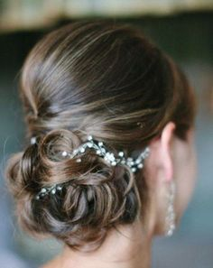 tight, low up-do... love  this with the babys breath
