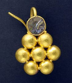 140 lbs of gold and silver coin and jewellery from the Byzantine era were found buried in the floor of a courtyard in Isreal Dainty  gold earring .