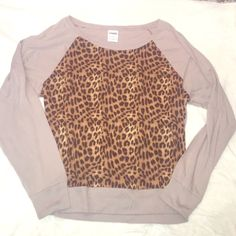 PINK Victoria Secret Leopard print long sleeve tee PINK Victoria's Secret leopard print long sleeve tee. Cotton and modal. Never worn. No flaws or stains. Size small. Length is 24 inches. PINK Victoria's Secret Tops Tees - Long Sleeve