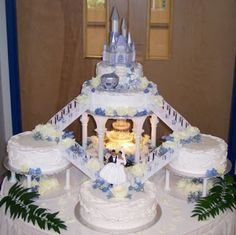 Multi-tiered Cinderella Castle Wedding Cake in soft metallic blue, tiers are separated with staircases.