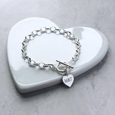 Gorgeous sterling silver heart charm bracelet / personalised anniversary gift / gift for Mum. Add one or two heart charms with one word engraved on each side. Silver Charms, Sterling Silver Bracelets, Clean And Shiny, Two Hearts, Gifts For Mum, Heart Charm, Valentine Day Gifts, Anniversary Gifts, Jewellery