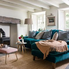 Teal living room ideas - warm up your lounge with this vibrant hue. Choose bold teal wallpaper, paint a feature wall or add a teal accent chair. Teal Living Rooms, Living Room Designs, Pink And Grey Wallpaper, Inglenook Fireplace, Fireplaces, Teal Sofa, How To Make Headboard, Single Bedroom, Bedroom Images