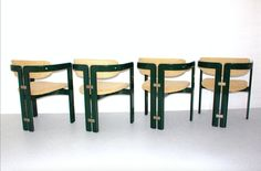 This set of 4 chairs are designed by Augusto Savini 1965, Italy and executed by Pozzi, Italy.  The chairs are recovered with a light woolen fabric.