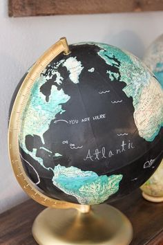 I have seen people with little globe collections and think they are so  cute. A while ago I found this globe at a thrift store and recently decided  to change it up a little so that the kids could have fun drawing on it. I  just used some chalkboard paint and slowly painted the oceans. It took two  or three coats. When that dried, I covered up the globed and spray painted  the metal parts gold. The old color was looking a bit dingy.  Parker  especially, loves to draw on it. Usually, its…