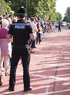 Warwickshire Police officer by crowd (via Ben East)