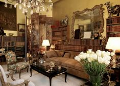 Coco Chanel's apartment above the Chanel boutique ~ French style with oriental styling, Victorian opulence and Russian coloring -- lots of cream, black, maroon and splashes of warm gold (3rd of five pins)