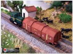 Vagón portabobinas de ejes JTL2. Rojo óxido. Envejecidos.  Serie especial limitada de vagones realizada por Trenmilitaria a petición del foro Trenes H0.   Algunas unidades han sido montadas, pintadas y en algunos casos envejecidas por Ju5.   Más imágenes del proceso de montaje del vagón del foro, en librea rojo óxido envejecido en: http://ju5ffcc.blogspot.com.es/2013/08/vagon-portabobinas-de-ejes-jtl2-rojo.html.