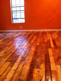 Varnished pallet wood floors. They look a little orange because we painted the walls burnt orange (Hook 'Em Horns). Lots of time involved but worth it because the pallets were free.