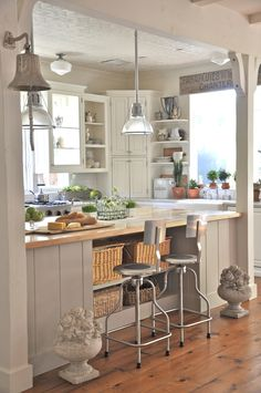 My next kitchen will be gray and off-white, please.  I love all the accesories here, including those stone topiaries.  I have a pair of faux ones.