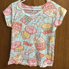 """Light blue kawaii donut bear shirt From Spreepicky. Does not fit me how I wanted it to, it Runs small. The size says its """"one size fits all"""" but it came out small on me. Length:56CM/22""""  Bust:96CM/37.73"""" the material is very thin and not stretchy. It's super cute though and has bears, donuts and popcorn printed all over it. Spreepicky Tops"""