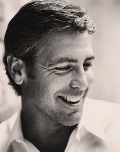 Goerge Clooney.  What a smile, handsome even unshaven. Oh my oh my!