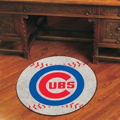 Baseball-shaped area rugs by FANMATS. nylon carpet and non-skid recycled vinyl backing. Chromojet printed in true team colors.Team Name: MLB - Chicago Cubs. Cincinnati Reds Baseball, Chicago Cubs Baseball, Chicago Cubs Logo, Chicago Cubs Gifts, Sports Rug, Sports Teams, Cubs Team, Baseball Equipment