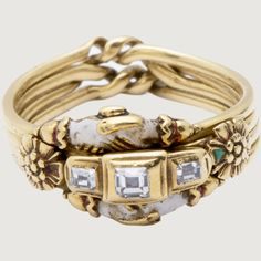 FEDE PUZZLE RING, CLASPED HANDS. Germany, early 17th century. Gold, foiled diamonds, brown, green, and white enamel.
