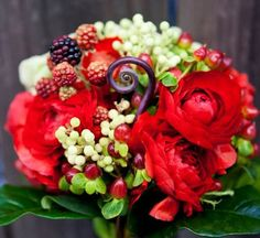 Red Bouquet using hypericum berries, rasberries, hydrangea and ranunculas.