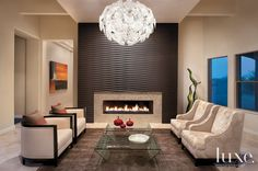 Mediterranean Cream Family Room with Linear Fireplace