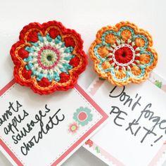 Crochet flower fridge magnets