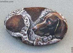 Hand painted rocks: dogs: German Shorthair Pointer      ***This is neat when I see paintings on rocks-so good. :)