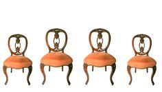 A set of four walnut dining or occasional chairs with cabriole legs and renovated upholstered seats. and exquisite back carving.                                                                                                                                                                                                                                                           C.1890 English.