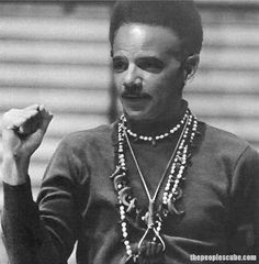Black Racist  Panther Eric Holder arrested for armed takeover of Columbia University building. Scum at DOJ.
