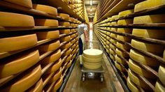 Cheese maker and farmer Alexandre Murith transports wheels of cheese for delivery at the ripening cellar in Gruyeres, western Switzerland, J. Caves, Factory Architecture, Cheese Factory, Cheese Maker, Raw Milk, Tim Beta, Gruyere Cheese, Iron Age, Sustainable Architecture