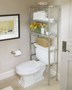 An étagère over cistern ~ great storage idea for a small powder room ~ bathroom