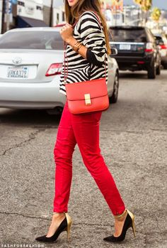 black and gold pumps, red pants, striped top. Urban chic.