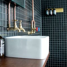 The bathroom at was a stand-out, with matte black mosaic tiles and exposed copper piping leading to a monsoon shower head -… Loft Bathroom, Tiny House Bathroom, Basement Bathroom, Basement Bedrooms, Steam Showers Bathroom, Small Bathroom, Bathroom Ideas, Copper Taps, Paint Your House