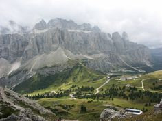 View of Gardena Pass and Sella group - a part of the dramatic Dolomite mountains. Gardena Pass (Italian: Passo Gardena; German: Grödnerjoch; Ladin: Ju de Frara or Jëuf de Frea) is a high mountain pass in the Dolomites of the South Tyrol in northeast Italy. At an elevation of 2,136 m (7,008 ft) above sea level, the pass connects Sëlva in the Val Gardena on the west side with Corvara in the Val Badia.