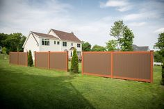 Illusions V300-6 Tongue and Groove vinyl privacy fence panels shown in Brick Red (E108) and Brown (L106). If you're looking for the great backyard idea of a PVC vinyl brown or brick red fence, Grand Illusions Color Spectrum is your match. #fenceideas #homeideas #yardideas