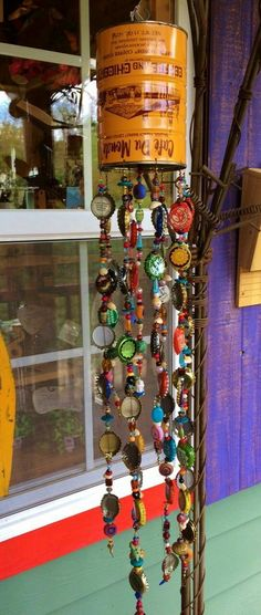 Recycled Coffee Can Windchime with beads and bottle caps! Lot& of whimsy go. - - Recycled Coffee Can Windchime with beads and bottle caps! Lot& of whimsy go… Recycled Coffee Can Windchime with beads and bottle caps! Lot& of whimsy going on here! Tin Can Crafts, Fun Crafts, Diy And Crafts, Coffee Can Crafts, Bottle Cap Projects, Bottle Cap Crafts, Garden Crafts, Garden Art, Carillons Diy