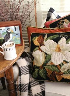 Elizabeth Bradley Magnolia needlepoint panel trimmed in complementary fabric and sewn into a pillow.