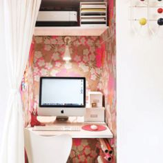 office in a closet (like how the printer w/various papers in a organized holder are raised up so that there is room down lower for other things)