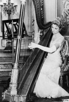 Grace Kelly Playing a Harp, 1/20/1956-Hollywood, CA
