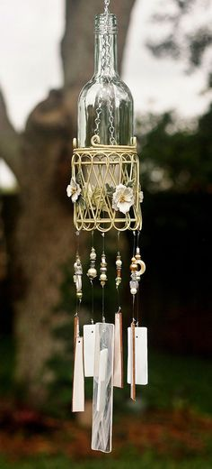 Wine Bottle Wind Chime - Blossom is made from Clear Wine Bottle, Stained Glass, Beads and Crystals and Unique Up-cycled Metal Basket.