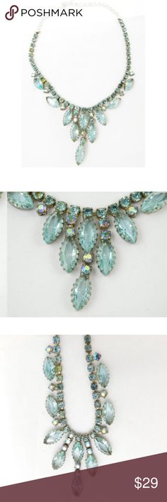 "Aurora Borealus Crystal Vintage Waterfall Necklace Aurora Borealus Crystal Blue Vintage Waterfall Necklace  Dress up any outfit with this lovely vintage, crystal, waterfall necklace.  Choker style Circa 1960's Light blue colored crystals with rainbow prisms Hook closure Smaller crystals on chain Waterfall crystals drop from chain Length 15"" Center drops about 1.75""  Condition: No major flaws. Light tarnishing and slight scratching from normal wear…"