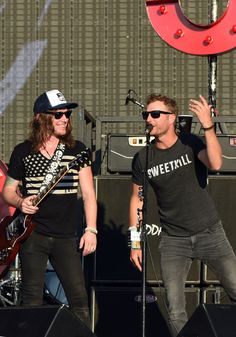 Dierks Bentley Photos Photos - The Cadillac Three's band member Jaren Johnston is joined by Dierks Bentley at Country Thunder USA In Twin Lakes, Wisconsin - Day 2 on July 24, 2015 in Twin Lakes, Wisconsin. - Country Thunder USA in Twin Lakes, Wisconsin - Day 2