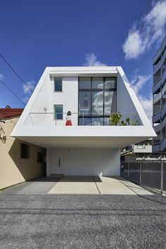 Completed in 2017 in Nagoya, Japan. Images by APERTOZERO . . It is three stories residence near the central Nagoya city. Requirements of client are 4 parking spaces (2 of them are with roof) and high ceiling...