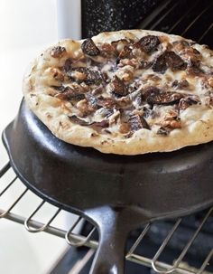 Cooking the pizza on an upside-down cast iron skillet.