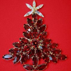 Dominique's gorgeous large 'Look of Stained Glass' Christmas tree brooch uses open back dark red fiery glass marquis stones and a sparkling clear white marquis rhinestone tree topper to complete its dynamite look from brendastreasures on rubylane.com!