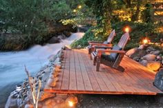 Create a deck patio seating area with comfy chairs along side a stream or river.  Add tables & ambient light.  Could do dining table to have picnics or eat meals here.