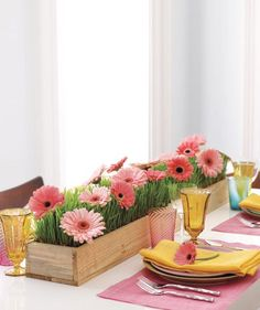 "A field of gerbera daisies and wheatgrass ""grow"" charmingly in a rustic table runner. Perfect for summer parties!"