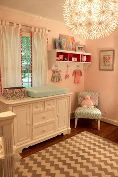 Great idea to use an entryway shelf in the nursery, paint the insides