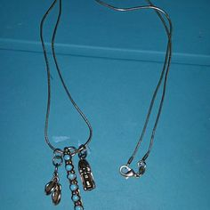 Sterling silver charm necklace Sterling silver snake chain with sterling silver flip flops charm. Sterling silver jet ski. Sterling silver turquoise in row pendant. Lobster clasp. Jewelry Necklaces