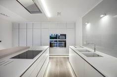 bulthaup b1 kitchen in Sand Grey matt lacquer. Structured oak breakfast bar. Miele and Gaggenau appliances. Corian worktops from Counter Production