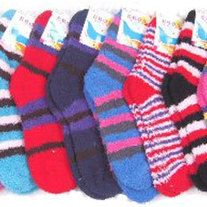 Keep warm this winter with this assortment of Ladies striped fuzzy socks. This picture is a sample of the available women sock styles. Case pack on these womens socks is 120 pair. Price is per pair.