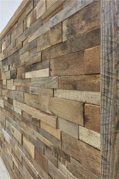 Reclaimed Barn Wood Stacked Wall Panels - interesting idea to accent or finish a rustic basement wall