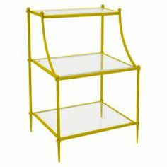 "Add an artful touch to your living room or master suite with this captivating etagere, showcasing 3 glass shelves and a vibrant finish.   Product: EtagereConstruction Material: Metal and glassColor: GoldFeatures: Three tiersDimensions: 26.77"" H x 18.5"" W x 14.57"" D"