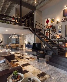 One of my favorite loft designs! CasaDesign Interiors did an incredible job designing Loft 44 located in Praia Brava Brazil! A modern industrial open concept layout with a cozy touch.