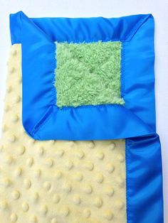 Yellow and Green travel baby minky blanket with silky border. With these colors it kinda looks like a frog!